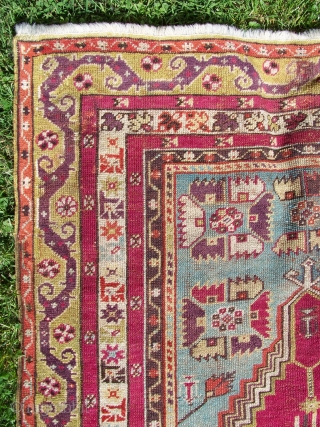 Kirsehir prayer rug with wonderful purple/green border. 69x43 inches. 19th century village rug. Woven upside down with prayer arch at bottom. Some reweaving in field. Great colors, including both madder and cochinel  ...