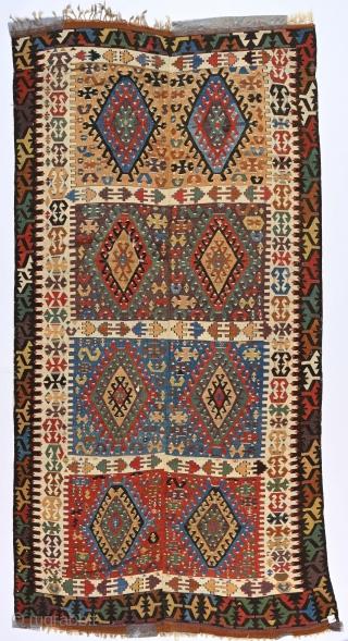 "Antique Anatolian long kilim, 5'4"" x 10'3"". Splendid colors. Metallic thread highlights. Apparently cut and shut just below top border. Last image shows true colors."