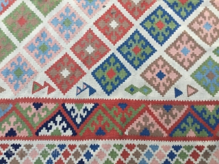Quashqai kilim, probably mid 20th century. Decorative pastel palette with white ground. Minor stains as shown. Ready for use. 110 x 65 inches (280 x 165 cm).