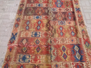 Anatlian Kilim with good colors and age,nice design,one part has been cut from center.E.mail for more info and pics.