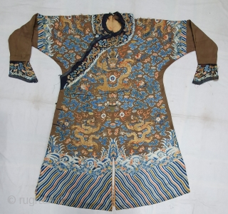 A very large and Beautiful Imperial Chinese dragon robe. Kesi woven with 9 dragons in pursuit of pearls among multicolour silk clouds, bats, and daoist symbols above wave and rock band. 19th  ...