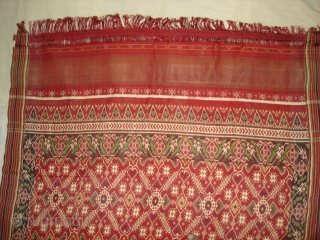 Patola Sari Silk Double ikat.Probably Patan Gujarat.India.19th Century.this Patola sari has the type of geometric,non figurative pattern particularly favoured by the ismaili Muslim merchant community of the Vohras.And its called Vohra-Gaji-Bhat.(Vohra Type  ...