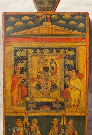 Worship of Shrinathji with Gopashthami pichhavai. Painting on wooden panel. Late 19th -early 20th century. Nathdwara. Rajasthan, India. This was most likely the lid of a wooden box which contained the deity's jewellery  ...