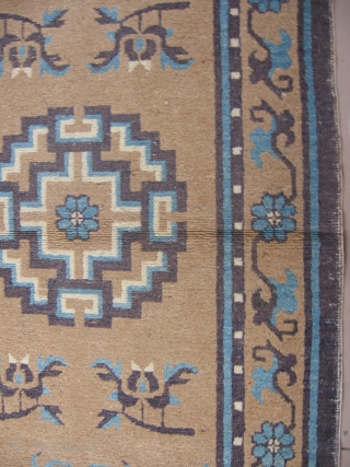 """This chinese rug probably dates 1900-1920. The darker purple-blue is slightly corroded in the corners otherwise the rug is in generally good pile. It measures 3' x 5'9""""."""