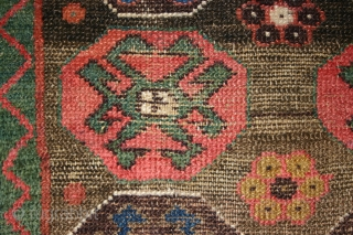Old Kurdish all wool rug, 115x178 cm. Great wool, colours and and some nice corrosion and wear. Both corners has lost some knots. Rug has no repairs. Picture number seven shows the place with most weare.