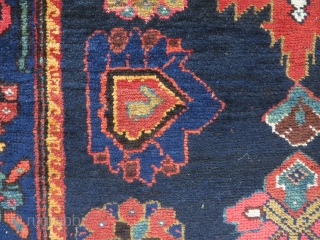 Perhaps a Feridan rug, in dozar size, made about 1930. OK condition with just some wear and nice colours.