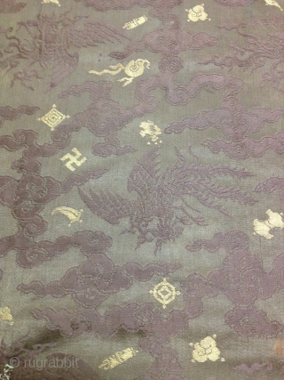 A female Tibetan Chuba (Female Robe), made from Chinese damask brocade silk in dark brown color, all hand sewn. Brocade motifs comprise of phoenixes floating among the scroll of clouds, with spray  ...