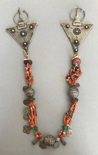Original Berber necklace with early fibula, having coral, amber, silver with enameling , glass, shell and jet .