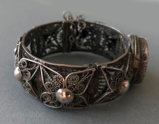 Very good quality silver filigree bangle with carnelian purchased in Morocco years ago but most likely from Yemen.