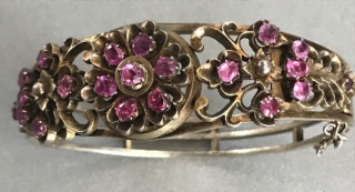 Gilt silver bangle with rose colored sapphires from Shri Lanka India circa 1940's.