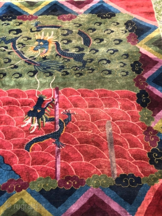 Deco Chinese carpet with pole dancing dragons on a super saturated and wild color palette. One of the most unusual designs I have come across . Measures 9.9 x 8.1 This has  ...