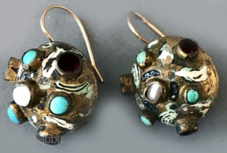 Austro Hungarian buttons , one as earring on gold wire . Enameled and with a central turquoise. late 18th/ or 19th c. sold each pair.