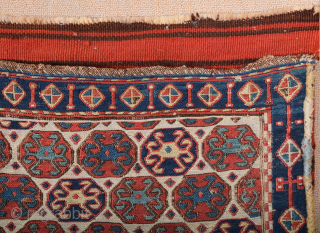 South East Caucasus, Moghan region Half of a Moghan Shahsavan Khorjin. The white-ground face woven in the Sumakh technique shows a repeat of offset rows of hexagons enclosing so-called spider güls. The  ...