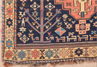 The field of this sumakh bag face shows a design of colourful diagonal stripes running at a flat angle and decorated with small madallion.The white border contains ashik designs and triangles. Probably  ...