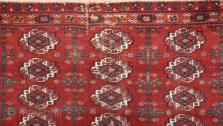 Central Asia West Turkestan Early 19th Century Saryk.This large Saryk Chuval displays twelve primary güls and chemche secondary designs in a dark red field. The main border contains diagonal crosses and hooked  ...