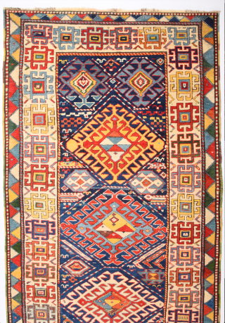 Colorful Middle of 19th Century Caucasian Gendje Rug. It's in perfect condition has good pile on it. It has rare colorful kilim selvedges Size 115 x 275 cm