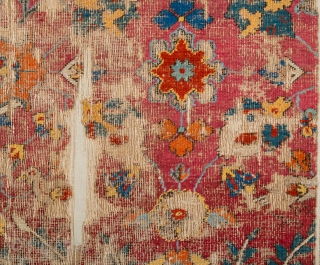 Persia Mid 17th Century Khorasan or Esfahan Rug Fragment.A fragment of a carpet woven in the court workshops of Esfahan. The primary design consists Lovely red  while further spiralling vines decorated  ...
