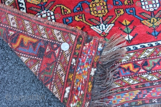 """Afshar inspired Khamseh pomegranite rug. 19th century to 1900. Size 3'8"""" x 2'8"""". Both endings and sides complete. One end with sumack finish. This is a small format rug not a bagface.  ..."""