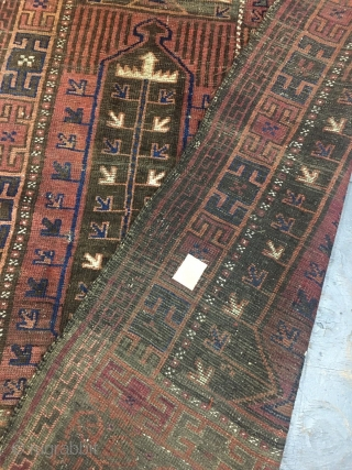 194 x 115 cm Antique Belouch in fair condition  but all original in sizes, selvedges and the 2 ends and without restors or repils. Very beautiful dark-green (malva). Archaic piece knotted very fine.  Wool on wool  ...