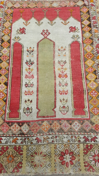 A very attractive antique Turkish rug , backed and conserved ready to hang or put on the floor some wear . Price does not include shipping