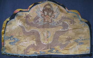 Rare fragment of a weaving for a semiformal imperial court robe, the 5 clawed dragon suggesting it was intended for the emperor or empress. Gold brocaded silk with a central Long among  ...