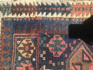 19th Century Kurdish rug with some damaged areas.
