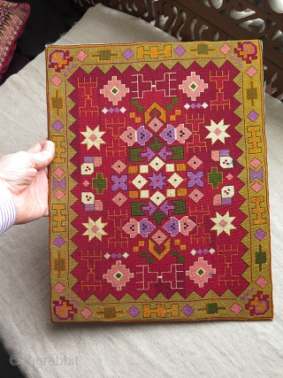 European very fine silk cross stitch textile. It was a large book cover. 
