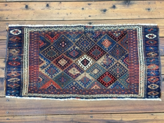 Early Jaf Kurd chuval fragment. Beautiful saturated natural colors that include a good variety of blues and blue-greens. Missing top and bottom borders.  Worn condition and with a patch from another  ...