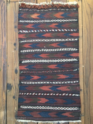 """Antique Baluch Kilim which appears to be a bagface to a grainbag. Very good condition and retains closure loops. Measures 42""""X 22"""". Hand washed. Shipping included in price."""