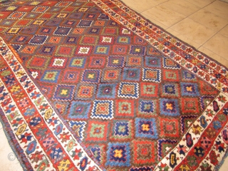 Antique Kurdish tribal rug with fantastic colors and shiny wool. Circa 1870. Size: ca. 260x140cm / 8'5'' x 4'6''ft The design of this village weaving  displays interlocking stepped diamonds that completely  ...