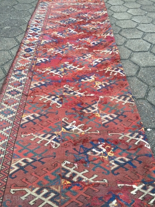 Antique Turkmen Yomud main-carpet with Dyrnak Gul design and a very nice Elem. Age: first half of the 19th century. A very old collector´s piece with some condition problems,