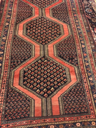 Antique Northwest Persian village rug from the Meshkin area. A perfect interaction between the pole medallion and the field design seperated by a brick red plane field. Size: ca. 405x155cm / 13'3''ft  ...