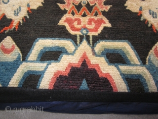 "Tibetan : Made up pillow with rug face, 1'7"" by 2'3"", snow lions facing fish and the conch shell. Looming up from below are two large flaming pearls. c.1930"