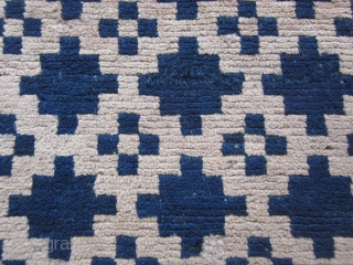 Tibetan khaden, overall geometric design in shades of undyed wool and a border with shades of indigo. About 3 by 5 feet. c.mid-20thC.Excellent condition. Wefting suggests a village product. Not expensive.