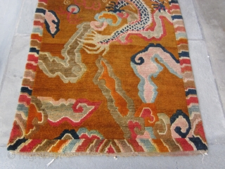 """Tibetan khaden with monster dragon cavorting through an orange-grounded, hallucigenic, cloud-banded sky.Don't miss the flaming pearl! Strikingly graphic. c.1920-30 2'10"""" by 5'8"""" POR"""