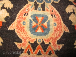 Tibetan mat as large pillow, 18 by 27 inches, note religious symbol of the conch shell, and also the two fish.