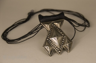 Old Khomeissa,  pure silver and leather hand made amulet from Niger. Khomeissa, a silver or shell pendant composed of 5 triangles, a variation of the Khamsa or Hand of Fatima worn by  ...