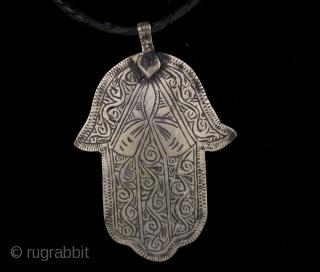 Old Berber pure silver Hamsa or Fatima's Hand, hand made amulet from Morocco, High Atlas region. The hamsa (Arabic: خمسة , khamsa, lit. five, also romanized khamsa and chamsa) is a palm-shaped amulet  ...