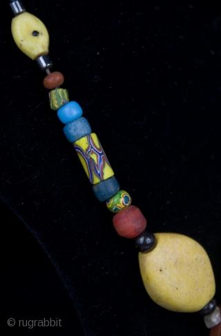 Old Millefiori, Venice mixed, Gablonz, Bohemia, yellow Kiffa glass beads, from Mauritania. Adrar region.  size:   lenght: 33 cm  diameter of beads: 0,5 cm-3,0 cm