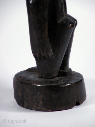 IBEDJ TWIN FIGURE YORUBA  Joruba Wooden twin figure, very old, excellent  patina. Base was  broken off and quite primitively reparated. From Nigeria  26 cm