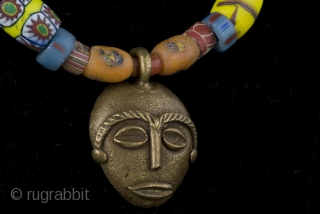 Old Venice, excavated Djenne, blue Nile trade beads and Baoulè bronze lost wax mask charm (Ivory Coast)  size :   lenght:  42 cm   diameter of beads: 0,5 - 1,5 cm  amulet: 3 cm x  ...