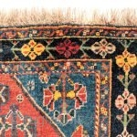A Qashqai tribe rug with a central medallion, a central field full of floral bouquets, even the borders are arranged with flowers. All dyes are natural, achieving a pretty range of terracotas,  ...