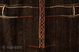Originally this kilim was a large Qashqai camel bag that has been opened out to make a kilim. It is woven with undyed black goat´s hair and for the dyed areas sheep´s  ...
