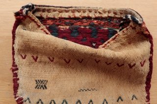 Small Qashqai mid century chanteh with soumak and floating weft embroidery onto warp faced cotton and wool ground, authentic used nomadic piece showing signs of wear consistent with age, 22cmx26cm.