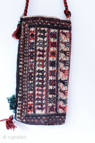 A Bakhtiari spindle bag. In many cases spindle bags are woven in one piece and folded over widthwise , as is the case in the present bag. All natural dyes, in mint  ...