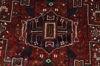 """A very similar rug can be found in Cyrus Parham """"Masterpieces of Fars rugs"""", plate 72. The limited, village-type carpet industry of Estahban District is primarily centered in the village of Eaj.  This  ..."""