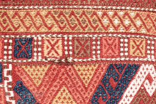 A kilim from the Obruk region, very finelly woven combining plain weave with cicim technique. The desing is composed of a well organised central field with two asimetric borders, both in terms  ...
