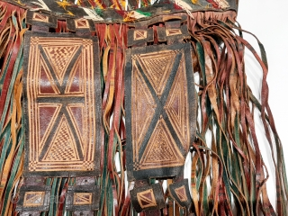 """Tuareg leather womans travel bag (""""aghrig""""), with hand worked and dyed leather, probably goat skin. Intricate leather work with check pattern cut into dyed skin and embroidered thread patterns. The green dyed  ..."""