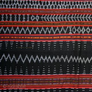Loincloth cod. 0416. Dyed cotton with glass beads woven in the cloth. Cotu culture. Central Highlands. Vietnam. Early/mid. 20th. century. Very good condition. Cm. 135 x 150 (53 x 59 inches).