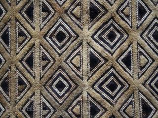 "Kuba Shoowa mat cod. 0713. rafia. D.R. Congo. Mid. 20th. century. Dimension cm. 62 x 55 (24.5"" x 21.5"")."